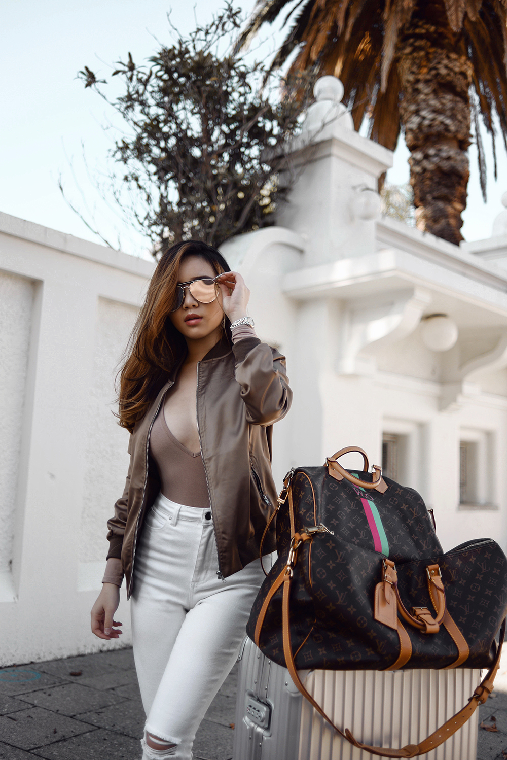 willabelle-ong-paledivision-street-style-fashion-travel-lifestyle-blog-singapore-australia-outfit-editorial-white-denim-jeans-bomber-jacket-louis-vuitton-duffel-bag-rimowa-luggage
