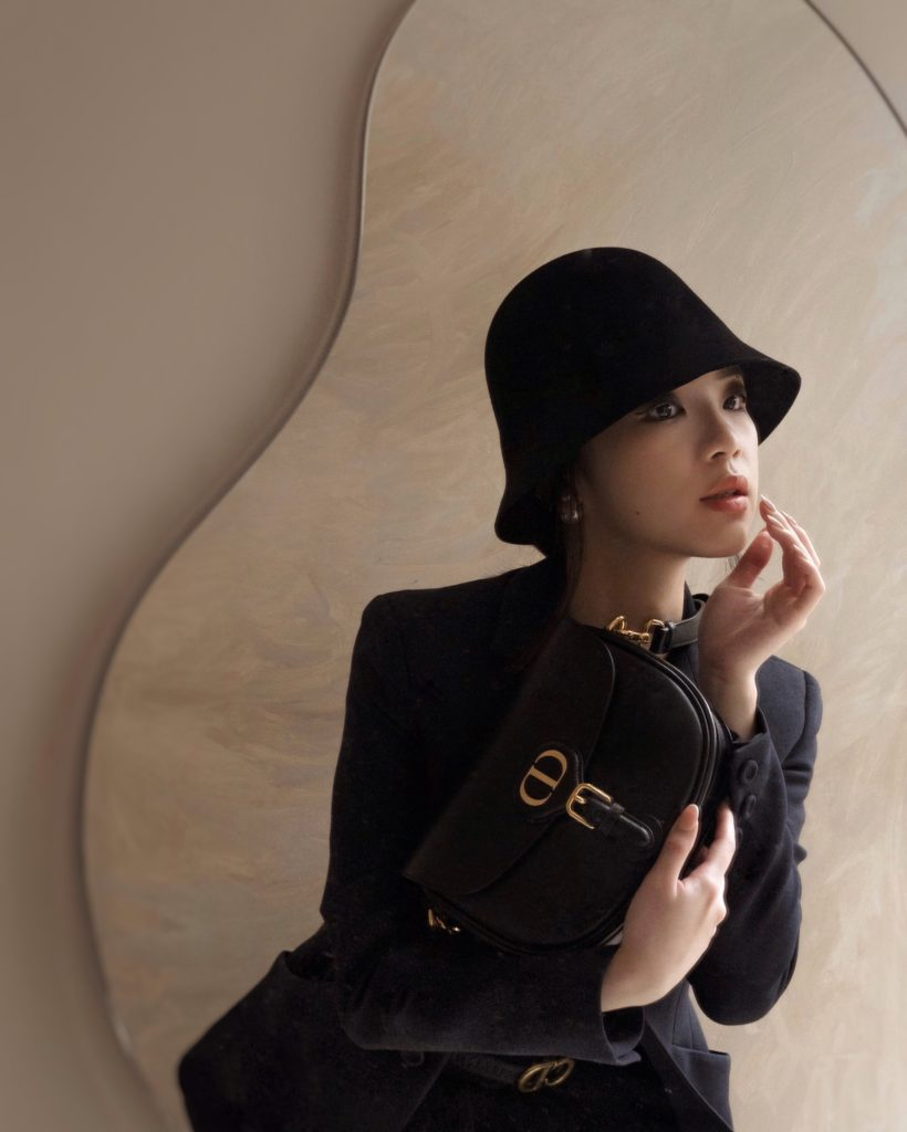 Dior's new classic and iconic bag, Dior Bobby in black calfskin, paired with Dior Bar Jacket. Photos By Willabelle Ong