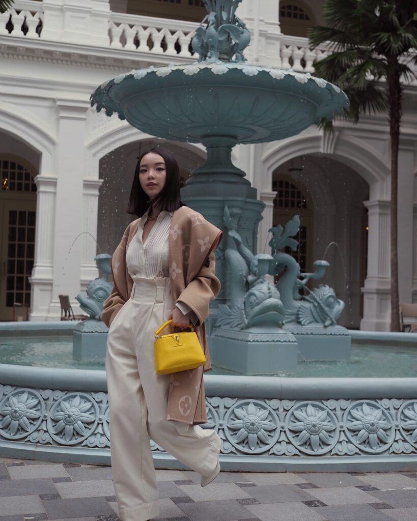Singapore Fashion Blogger and Digital Creative Willabelle Ong @willamazing wearing Louis Vuitton giant monogram jacquard wrap coat and LV Capucines bag in Bouton d'Or Yellow