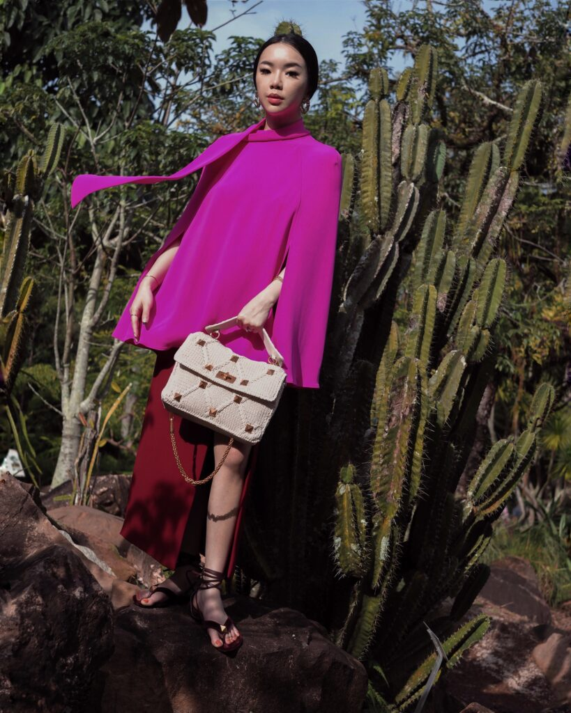 Singapore Fashion Blogger and Digital Creative Willabelle Ong @willamazing dressed in Valentino Resort Pink Cape Top with Valentino Roman Study Knitted and Woven Bag